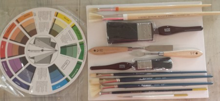 "Wayne Clements Painting Tool Set - includes Canvas board, Colour Wheel, Painting Knife, Mixing Knife, 1"" brush, 2"" brush, 2 x filbert brushes, 2 x fan brushes, 2 x Round Moon brushes and Liner brush."